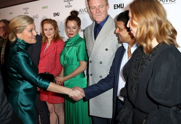 The Countess of Wessex wore a new silk-satin midi dress by Galvan London. BAFTA nominated director Julian Jarrold