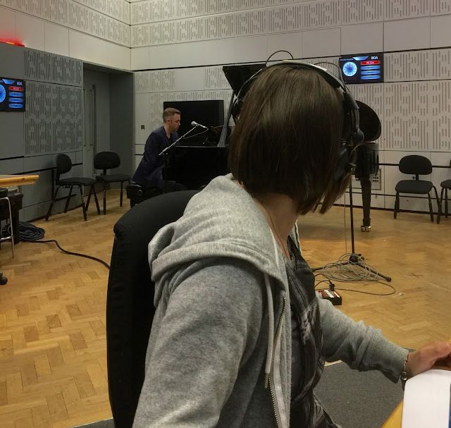 Host Kate watches on as Nichols plays piano in the studio