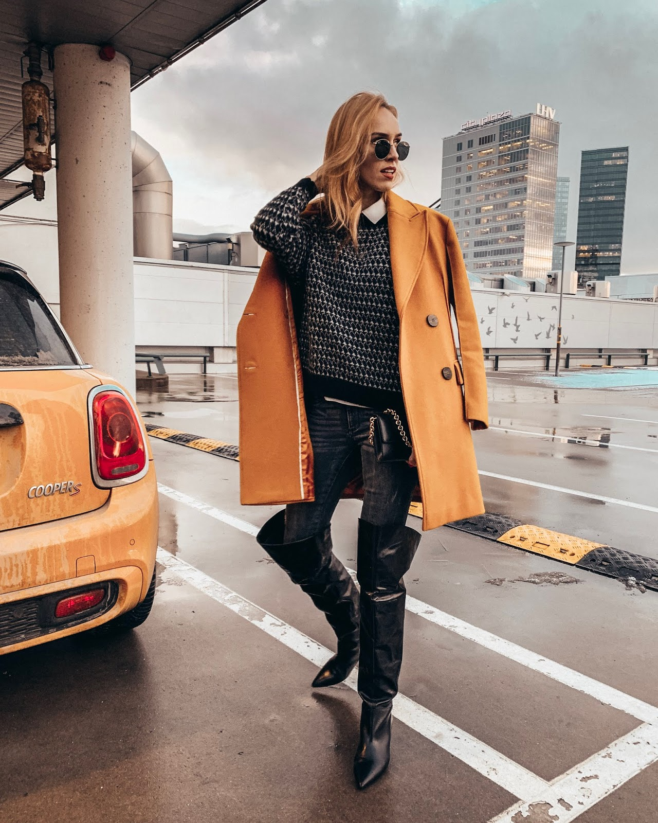 yellow coat black over knee boots outfit winter
