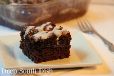 An easy, snack-sized chocolate cake, made with cocoa and chocolate chips and a smear of caramel sauce, poked into the warm cake, then finished with a powdered sugar icing drizzle.