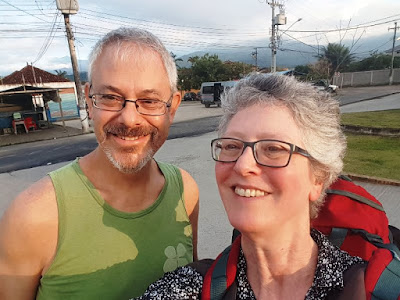 T and me at the bus station with a backdrop of mountains