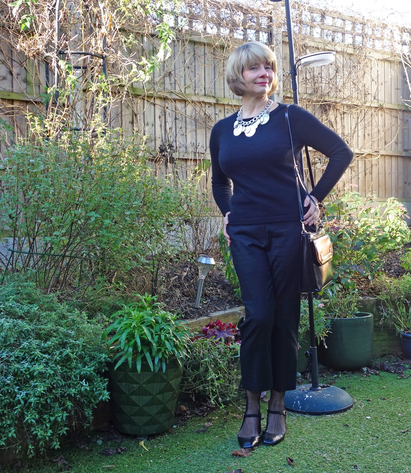 Blogger Gail Hanlon wearing black cropped trousers and black cashmere jumper