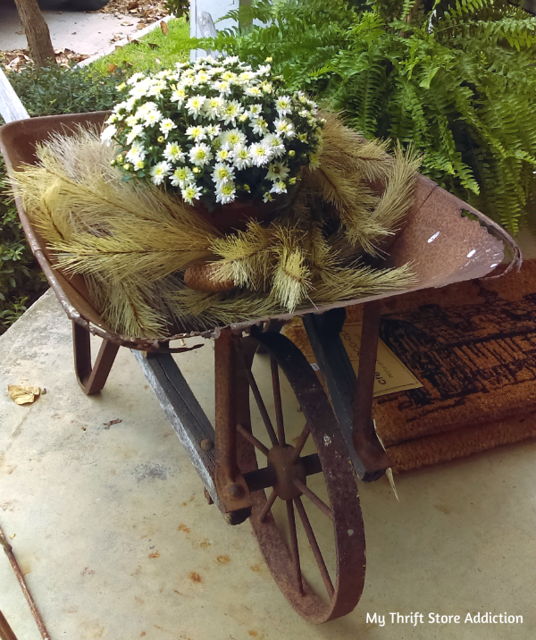 rustic flower filled wheelbarrow