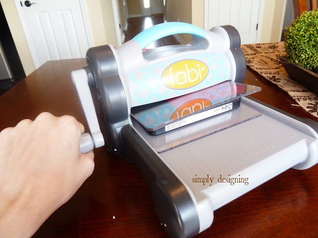 Sizzix | a fabulous machine for cutting fabric!  I cut 4 layers of felt at one time into perfect flowers!  Love this!