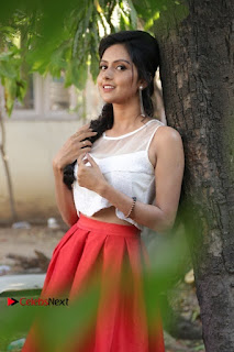 Actress Mahima Nambiar Latest Stills in White Top and Red Skirt at Kuttram 23 Movie Press Meet  0011.jpg