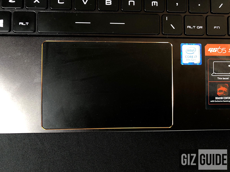Wide golden accented touchpad space