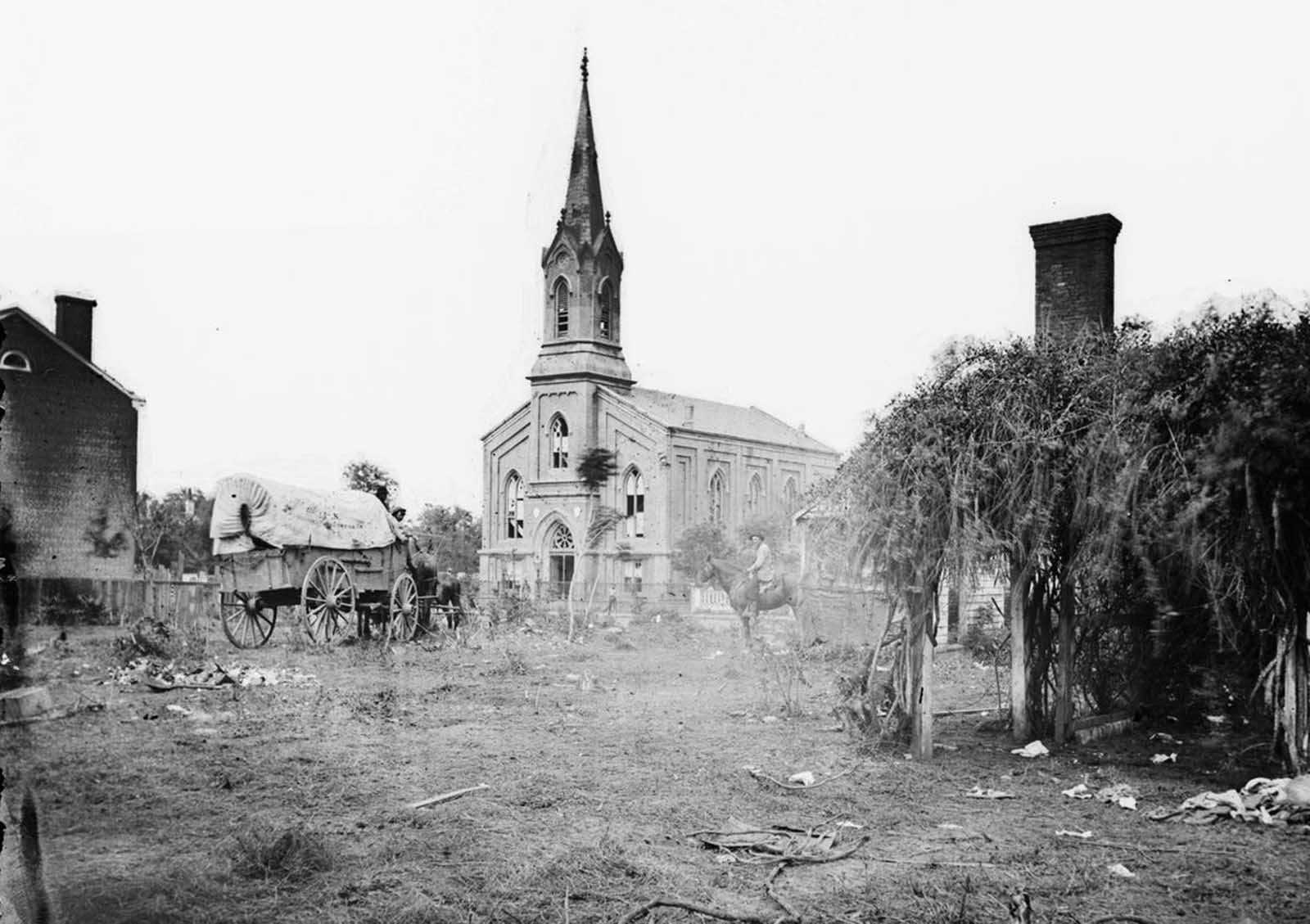 The Baptist Church in Fredericksburg, Virginia, photographed from the backyard of the Sanitary Commission depot on May 20, 1864, after the city had been damaged in two different major battles of the war.
