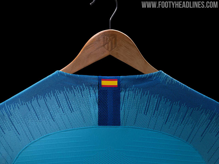 The Swoosh and the Plus500 sponsor logo on the new Atletico away shirt are  both bright red a53c32a24