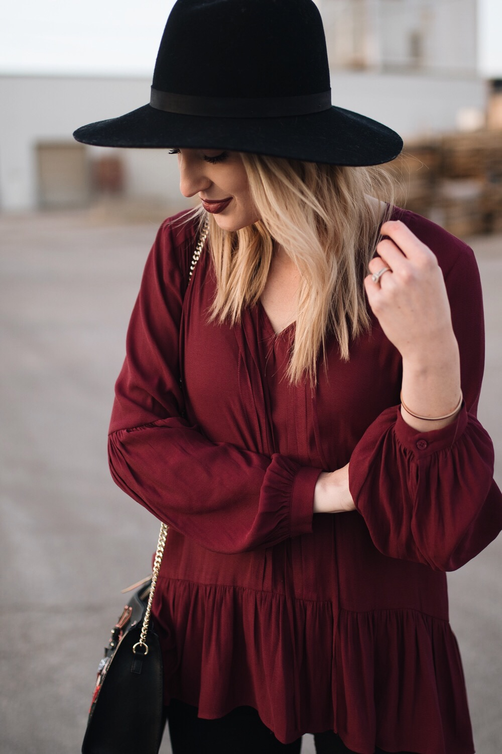 burgundy top with a black hat
