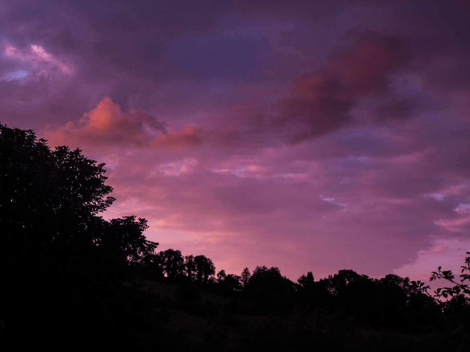 Purple sunset sky and clouds over trees in the Boggeragh Mountains, Co.Cork.