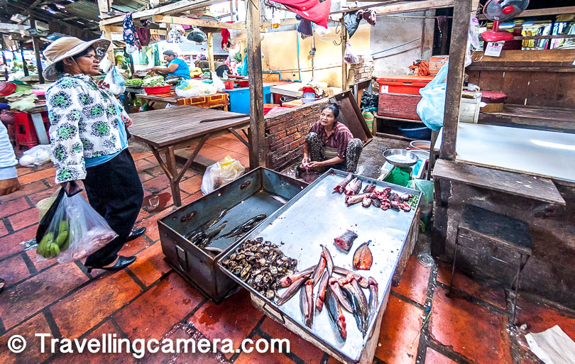 If the photograph above, the lady in this photograph is cleaning up different sorts of fish and other lady is helping to put the clean stuff the shop. The place was stinking buddies ladies happily doing their job and that's how it should be. Although I would always prefer a little cleaner space around the shops selling raw meat. Russian market of Phnom Penh is quite popular for raw/processed meat.