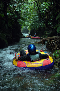 All About Bali Adventure tours tubing down the canyon cliffs natural river