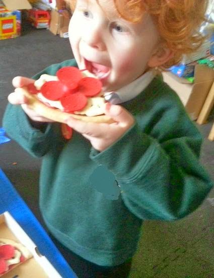 Green Toys 100% recycled cardboard toy Pizza Parlour Review boy pretending to eat pizza
