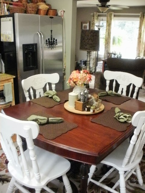 Formal mahogany table with casual white chairs