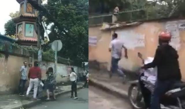2 phụ nữ rượt đánh người đàn ông trước chùa ở TP.HCM
