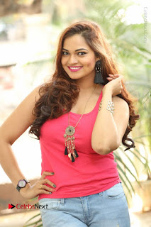 Tollywood Actress Ashwini Latest Stills in Ripped Jeans  0010.JPG