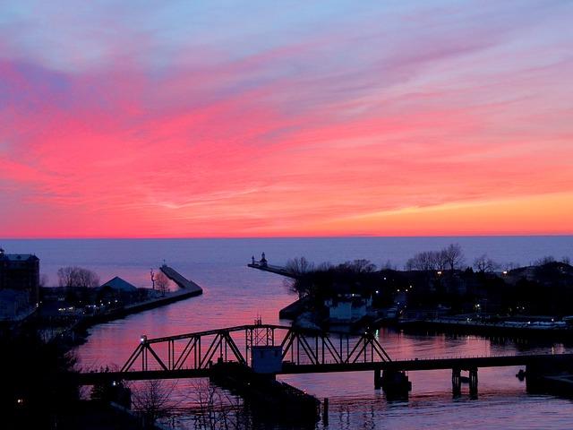 Beach, Bridge and Town at Sunset on Lake Michigan