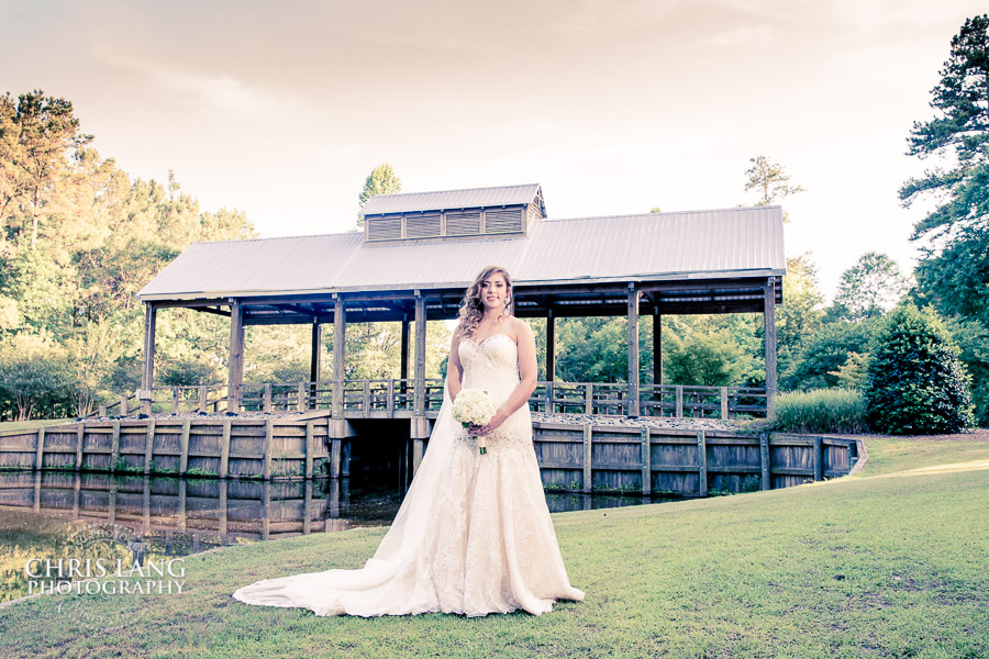 Image of a bride in here wedding dress at the covered bridge in River Landing Country  Club, Wallace, NC