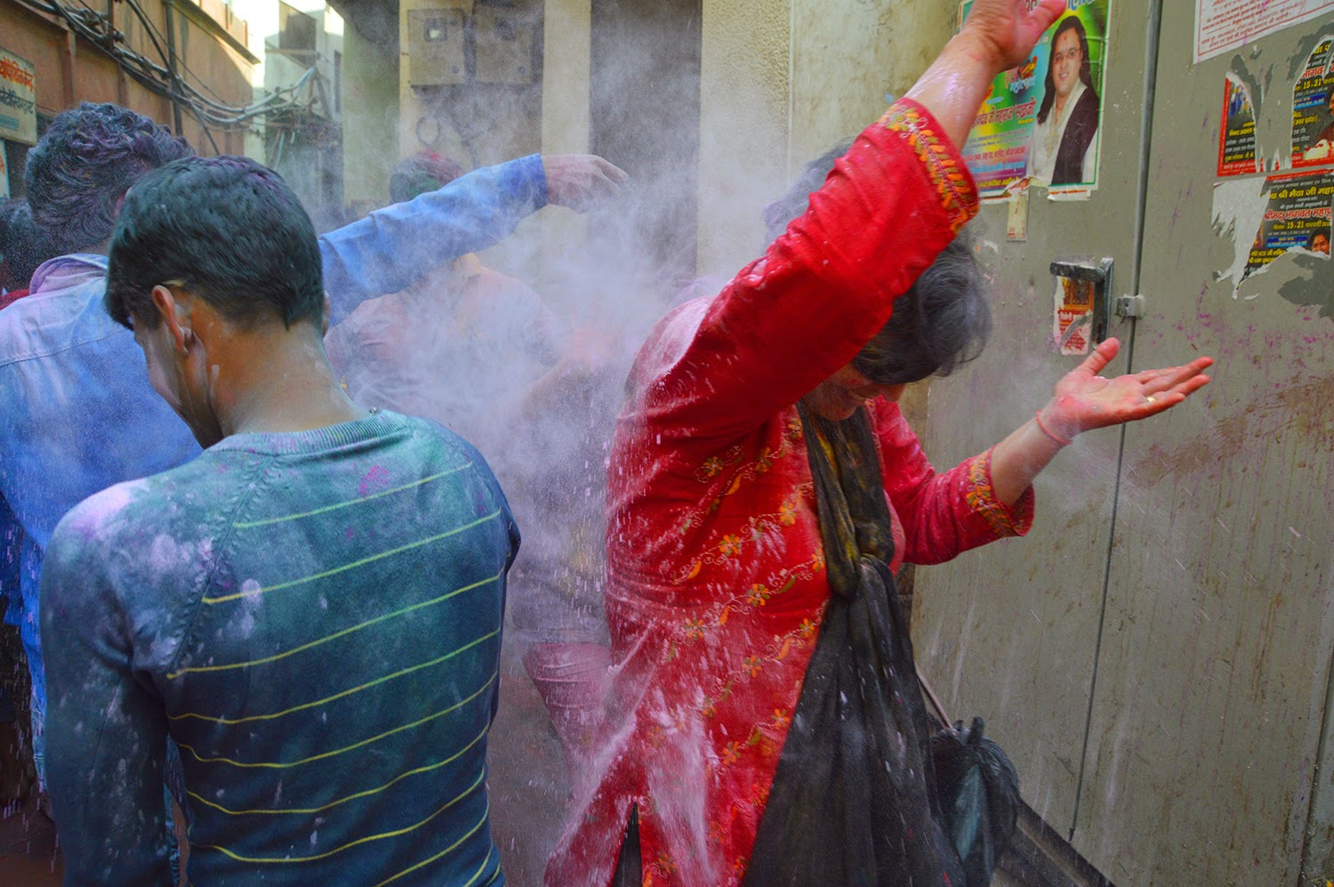 Women getting colored in holi Holi Banke Bihari Temple Vrindavan 2015 colors gulal red yellow green men