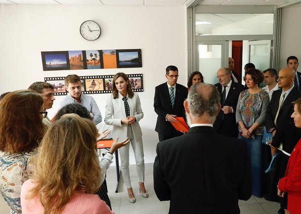 Queen Letizia wore Carolina Herrera blouse, Hugo Boss pantsuit at Spanish Cooperation Agency in Dakar