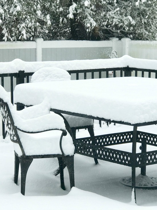 Patio furniture ideas on a new Trex deck before a snow storm