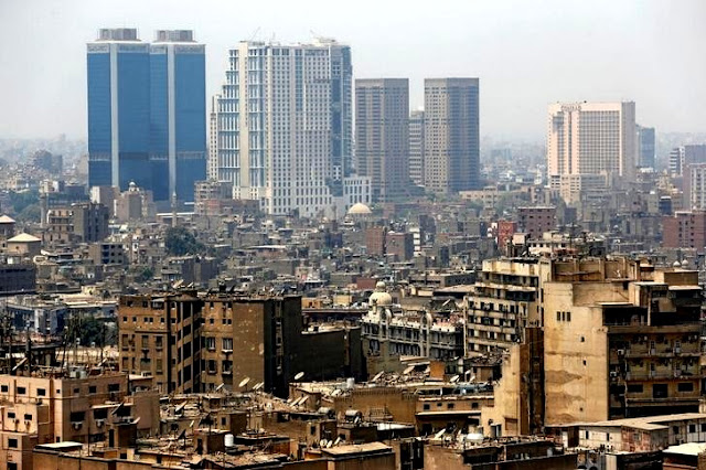 Image Attribute: Banks, hotels and office buildings are seen around residential buildings at the center of downtown in Cairo, Egypt August 11, 2016. REUTERS/Amr Abdallah Dalsh
