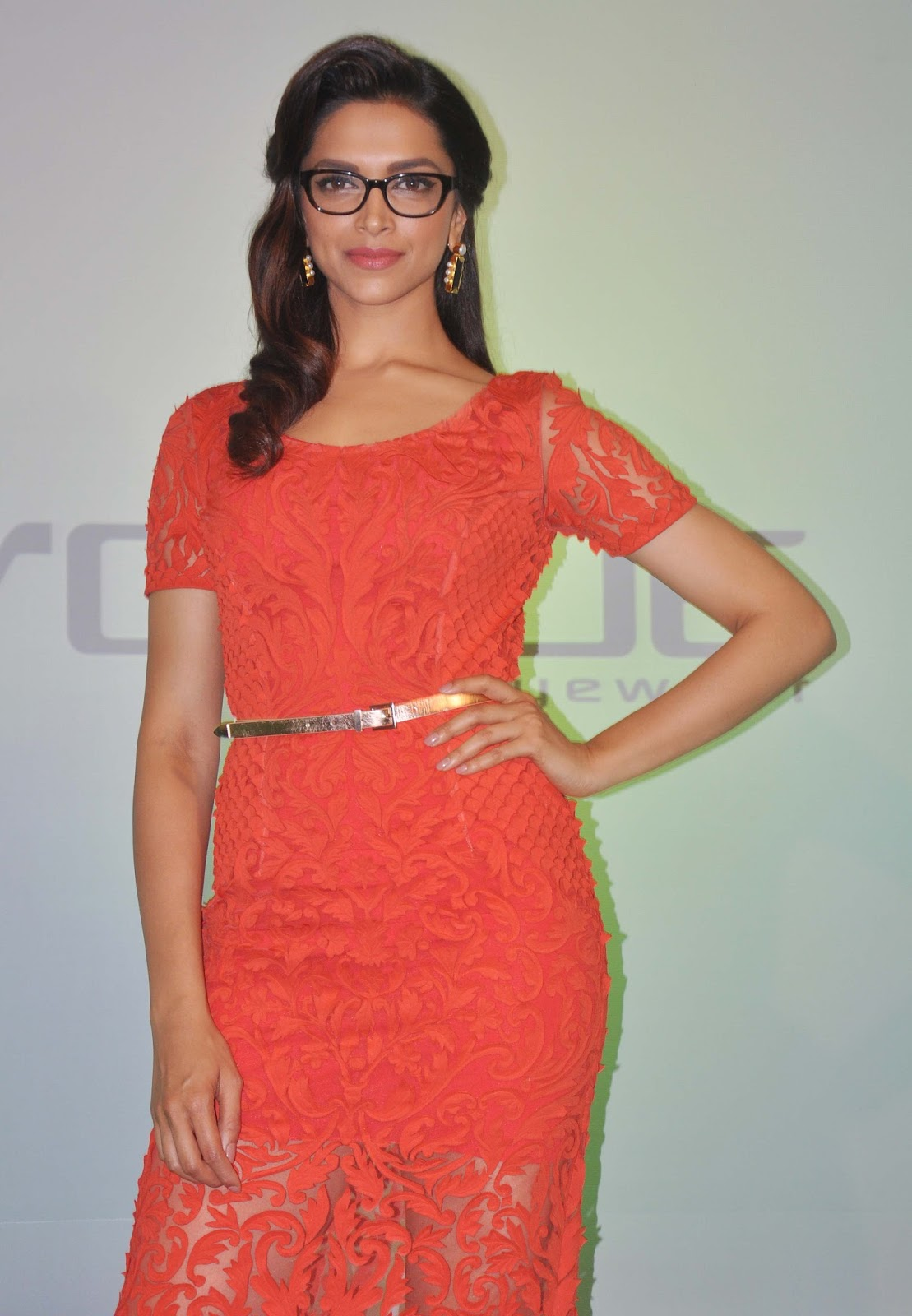 Deepika Padukone Photos In Orange Dress With Glass