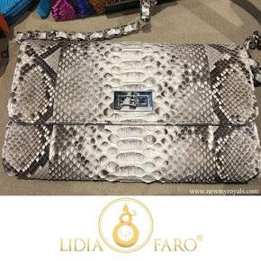 Queen Letizia carried Lidia Faro python skin clutch bag