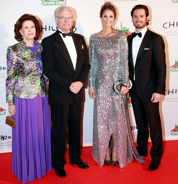 Roland Mouret Sarandon gown, Jimmy Choo Lisha pumps, Marchesa silver clutch
