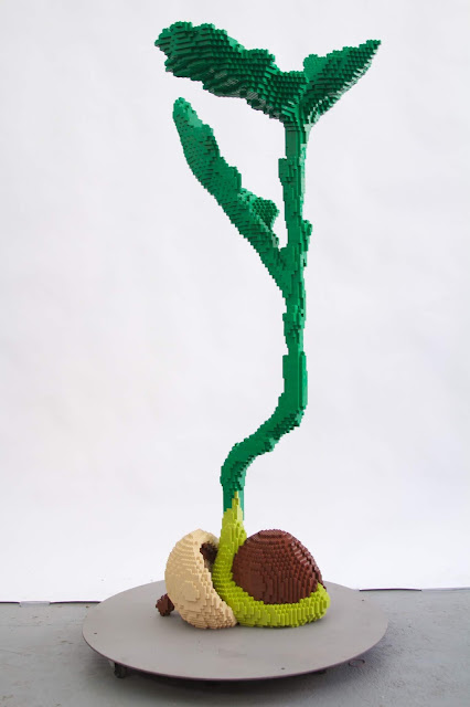 A tree growing from an acorn Lego sculpture crafted by Sean Kenney. Image courtesy of Morton Arboretum.