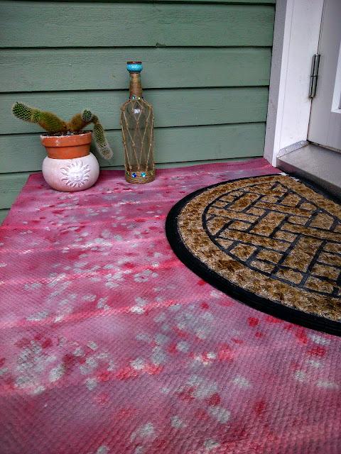 Spraymaalattu matto