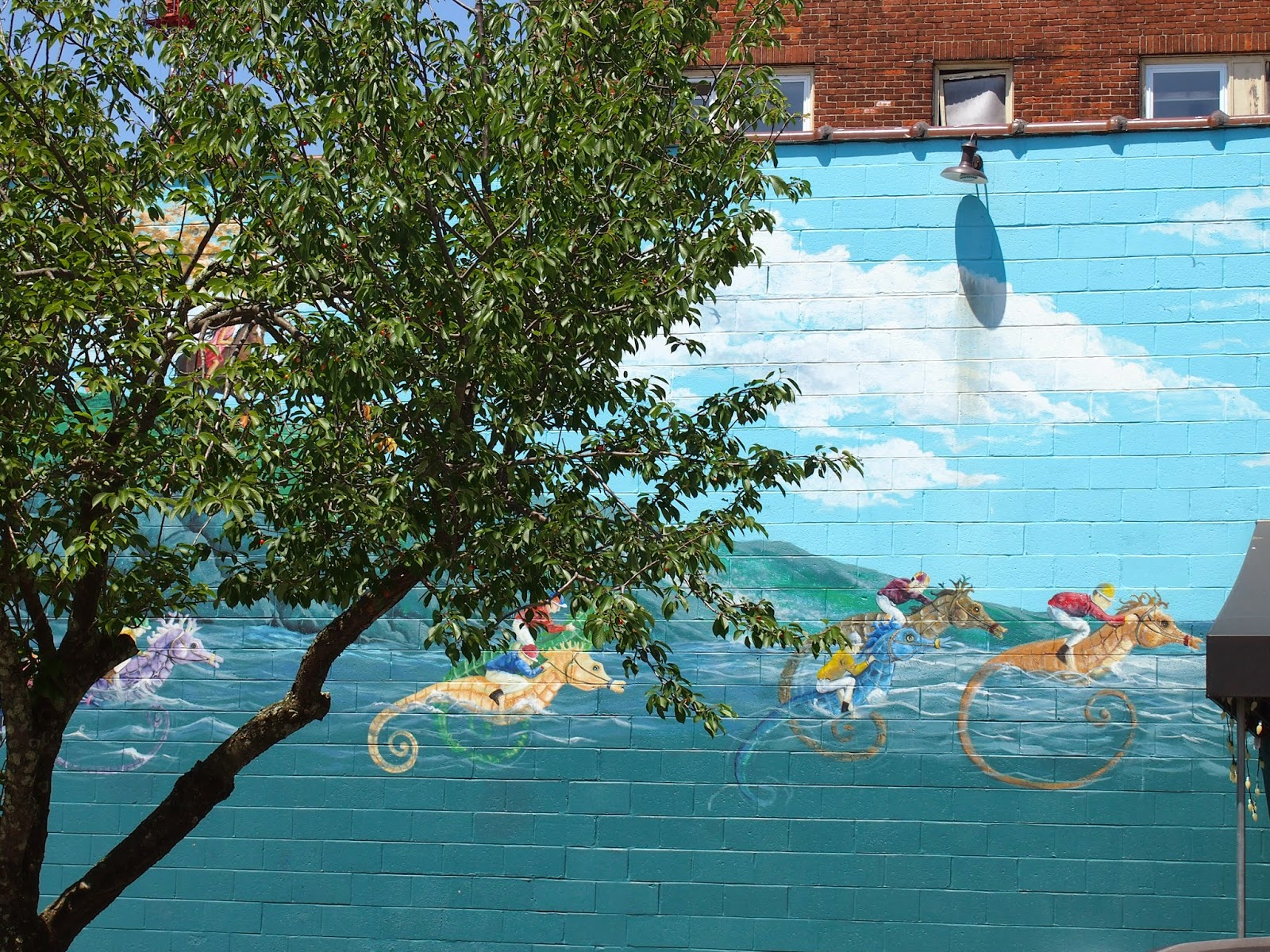 racing sea horses street art in New London, Connecticut