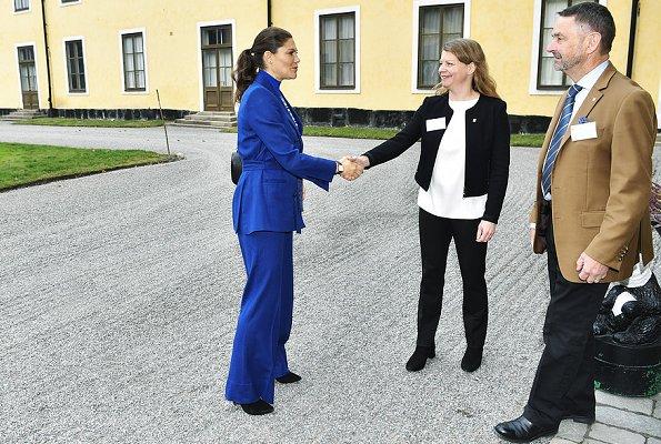 Crown Princess Victoria wore Rodejber Suit, Zoe blazer and darcel trousers and Baum und Pferdgarten Camellia Top