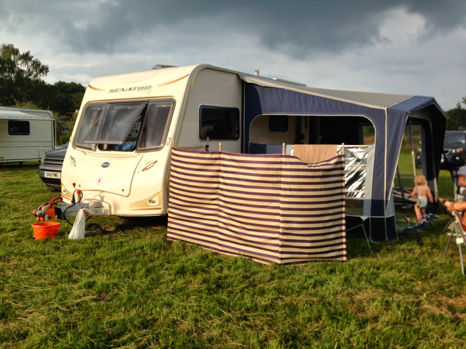 Caravan and awning under dark skies