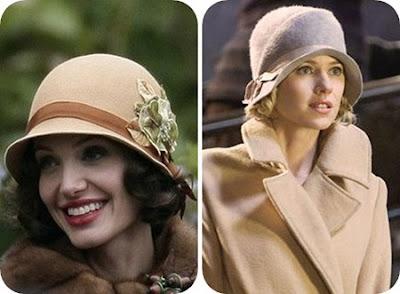 Angelina Jolie e Naomi com chapéu cloche