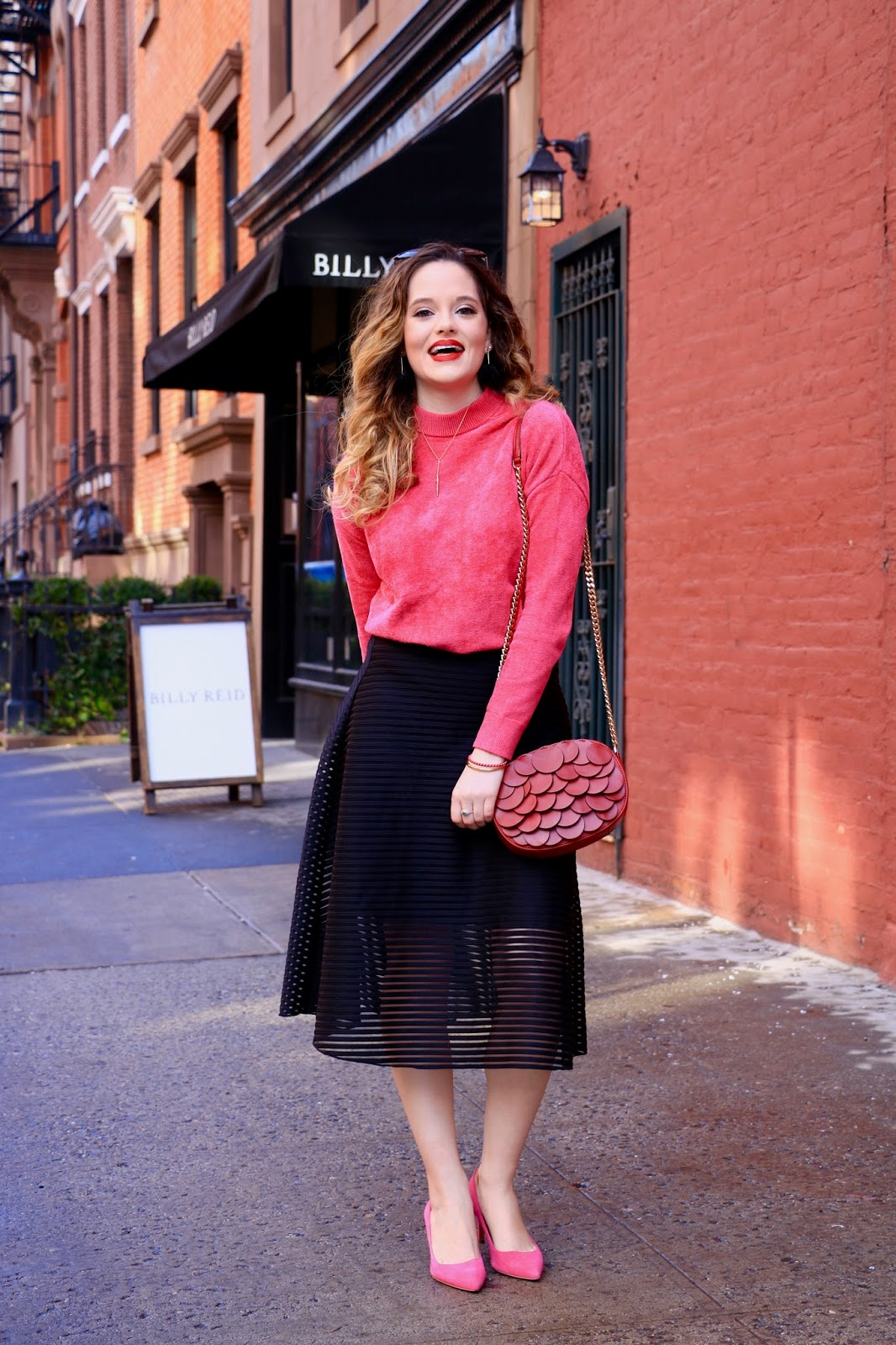 Nyc fashion blogger Kathleen Harper showing how to wear a skirt in the winter