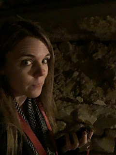 traveling solo female woman wanderlust europe backpack paris france catacombs