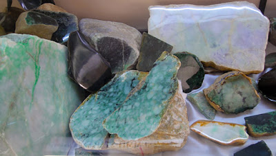 colorful raw jade stones including black
