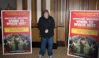 Michael Moore: Ban Guns, Retrain All Cops, End War
