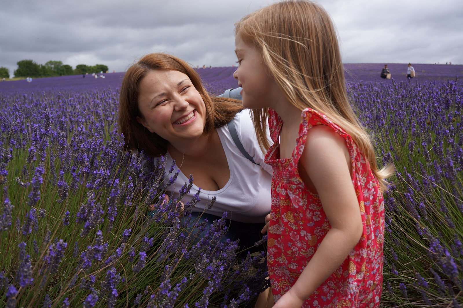 mum and daughter at a lavender field smiling