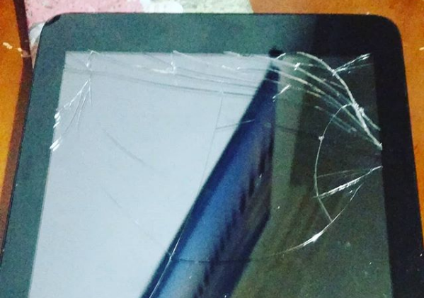a tablet with a cracked screen