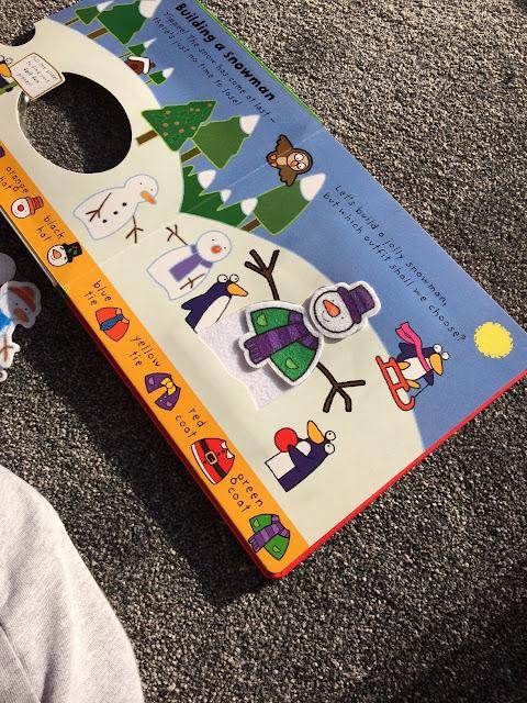 A christmas activity book with felt pieces