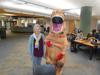 image of library staff and t-rex