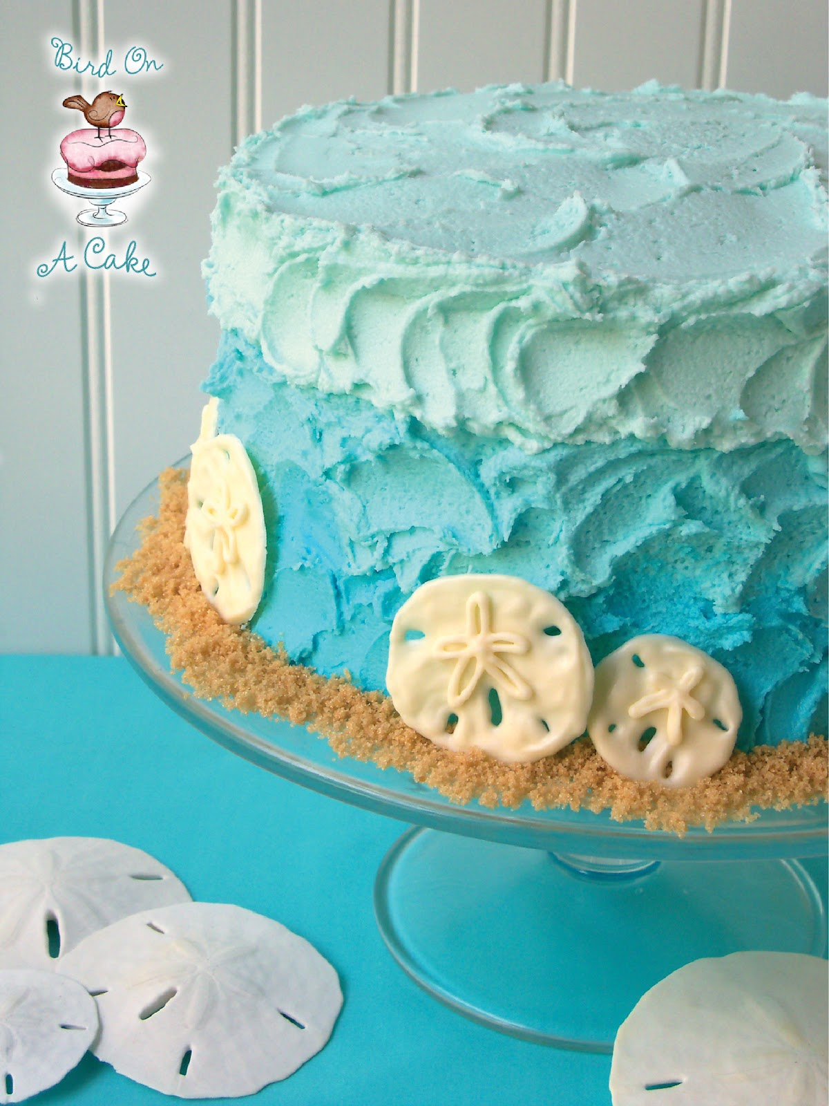 http://birdonacake.blogspot.com/2012/07/ombre-beach-cake-with-chocolate-sand.html