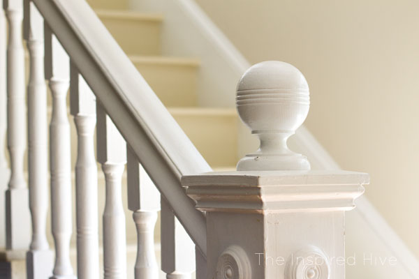 100 year old newel post with glossy white paint