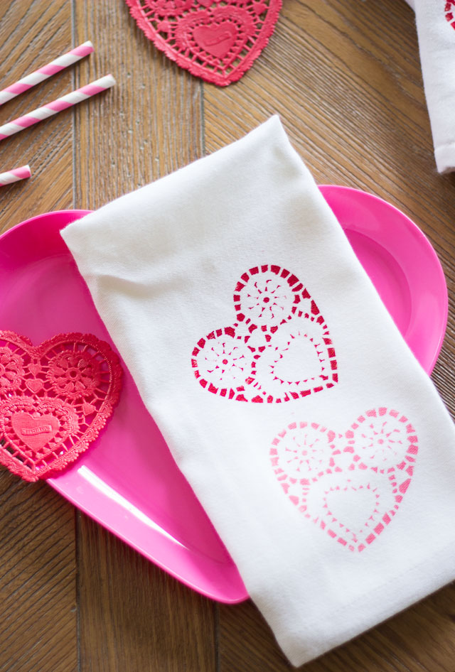 Valentine's Day heart napkins stenciled with paper heart doilies!