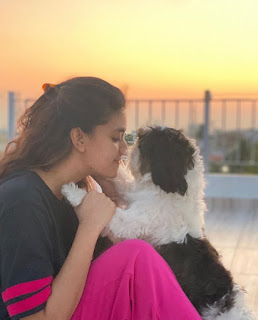Keerthy Suresh in Black and Pink Dress with Cute Smile with her Cute Dog at her Home
