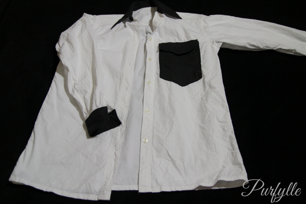 ugly white shirt with black pocket, cuffs, collar.