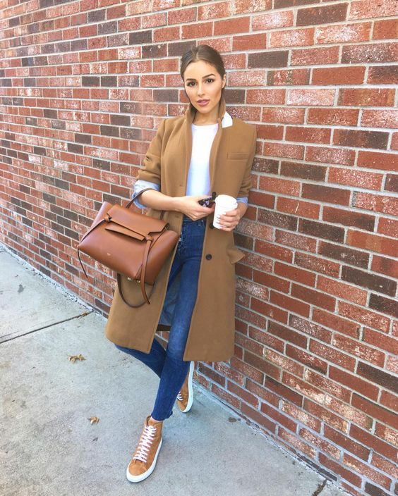 5c33adf3f8b A basic camel over coat is a staple you should have in your wardrobe, Here  she pairs it with a basic white tee, jeans, a classic bag and some trainers.