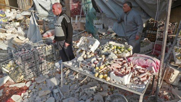 Syria war: Air strikes on Atareb market 'kill more than 50'